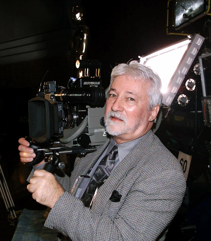 FILE - In this Oct. 26, 1999 file photo, originally released by the Academy of Motion Picture Arts and Sciences, Denny Clairmont of Moviecam of Austria, demonstrates the Moviecam Super Light Camera at the Academy of Motion Picture Arts and Sciences' Samuel Goldwyn Theater in Beverly Hills, Calif. (AP Photo/Academy of Motion Picture Arts and Sciences, Greg Harbaugh, file )