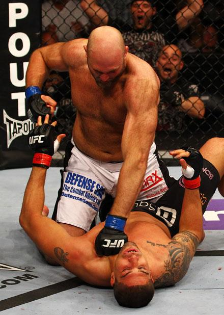 ATLANTA, GA - APRIL 21:  Ben Rothwell (top) punches Brendan Schaub during their heavyweight bout for UFC 145 at Philips Arena on April 21, 2012 in Atlanta, Georgia.