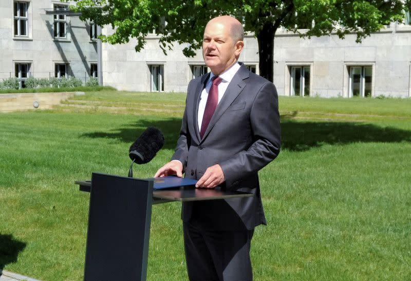 German Finance Minister Olaf Scholz gives a statement in the yard of the finance ministry during the spread of the coronavirus disease (COVID-19) in Berlin