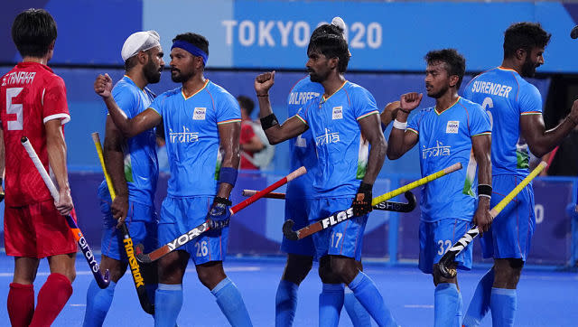 Striker Gurjant Singh scored twice as India men's hockey team, who had already qualified for quarter-finals, romped past Japan 5-3 in their final pool game. AP