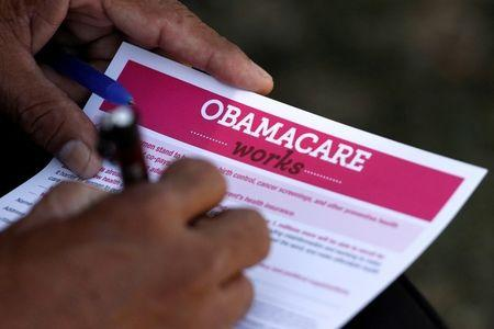 Trump administration freezes Obamacare funds