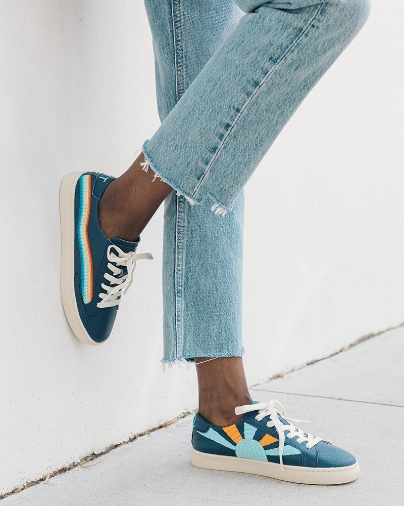 """<p>The <span>Rainbow Wave Sneaker</span> ($139) also come in this blue shade, and read """"Chill Out"""" in the back.</p>"""