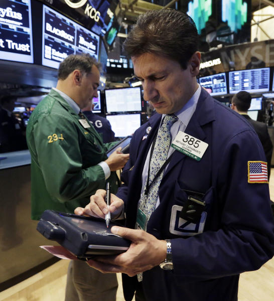 Trader Anthony Carannante, right, works on the floor of the New York Stock Exchange Monday, July 22, 2013. The stock market is opening mixed after McDonald's reported poor quarterly earnings. (AP Photo/Richard Drew)