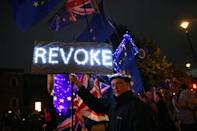 An anti-Brexit protester holds a placard outside the Houses of Parliament in London