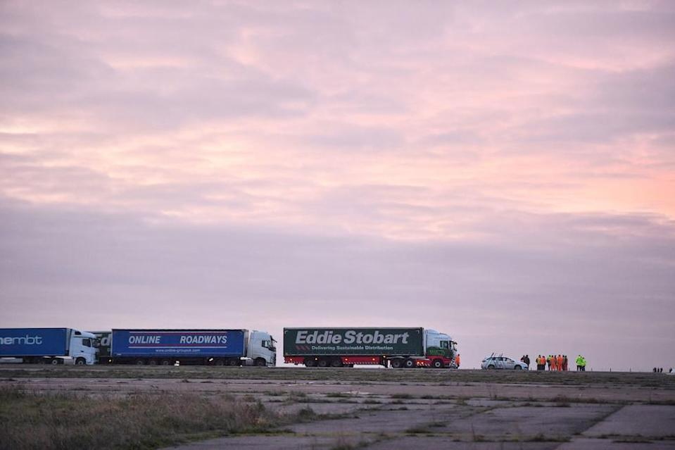 Lorries begin to line up during a trial at the former Manston Airport site in Kent of a government plan to hold lorries in the event of post-Brexit disruption at the channel ports (Picture: PA)
