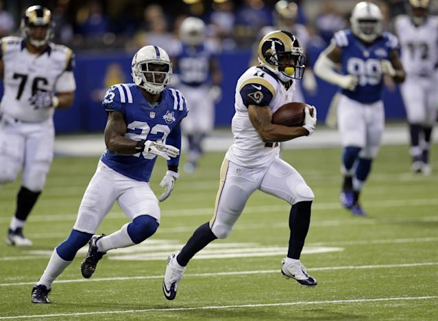 St. Louis Rams wide receiver Tavon Austin, right, runs in front of Indianapolis Colts cornerback Vontae Davis on his way to an 81-yard touchdown on a pass from quarterback Kellen Clemens during the first half of an NFL football game in Indianapolis, Sunday, Nov. 10, 2013. (AP Photo/AJ Mast)