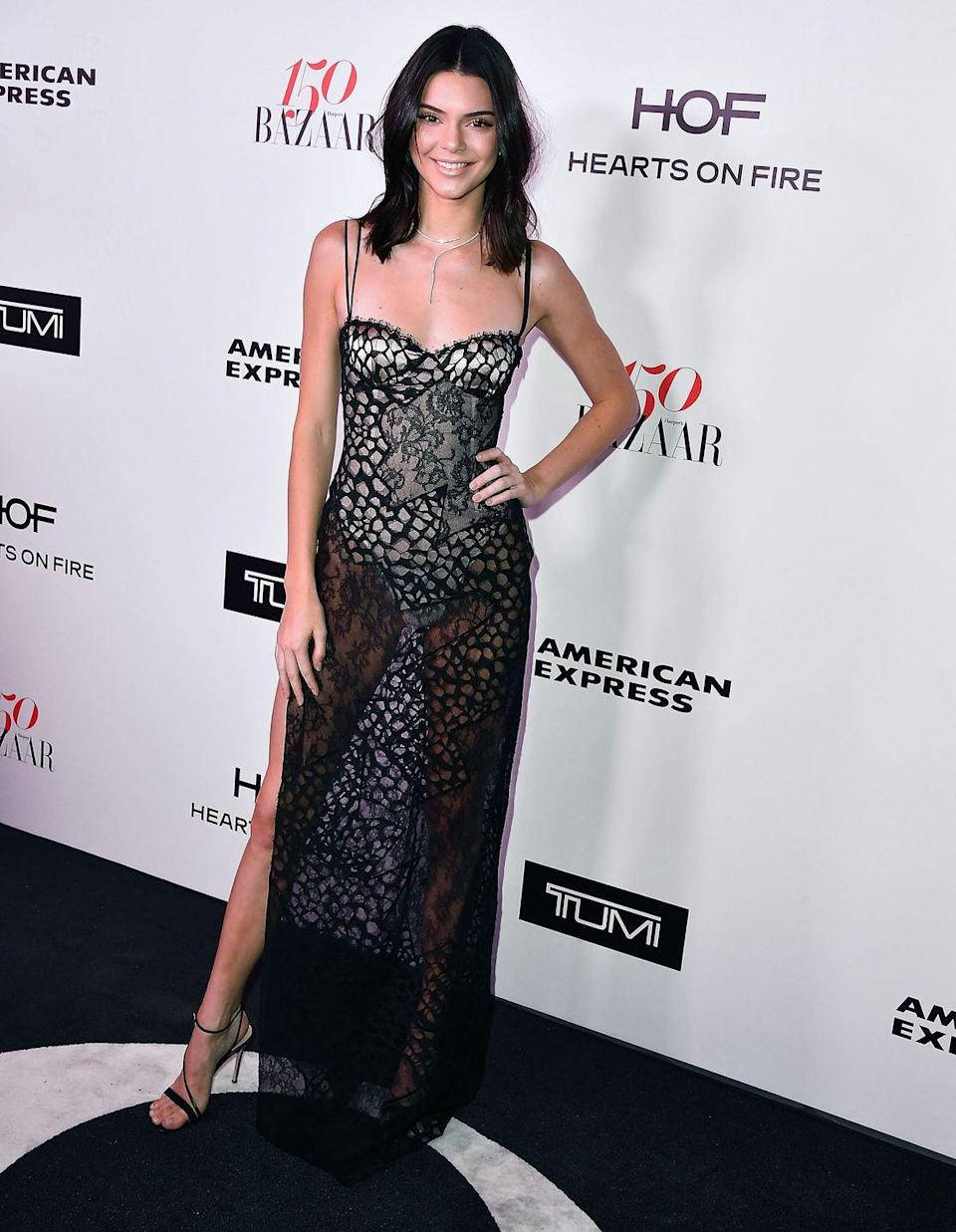 <p>Kendall Jenner, daring as ever, donned a La Perla lace slip for the Harper's Bazaar 150 Most Fashionable Women party.</p>
