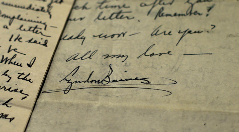 "The signature of Lyndon Johnson, then a 26-year-old congressional aide, is seen on a love letter sent to Claudia Alta ""Lady Bird"" Taylor, then 21, at the LBJ Presidential Library at the University of Texas, Wednesday, Feb. 13, 2013, in Austin, Texas. For the first time, the entire collection of nearly 100 love letters written between Lyndon Johnson and Lady Bird Johnson during their 21/2-month courtship in 1934 is being made available to the public, beginning on Valentine's Day. (AP Photo/Eric Gay)"