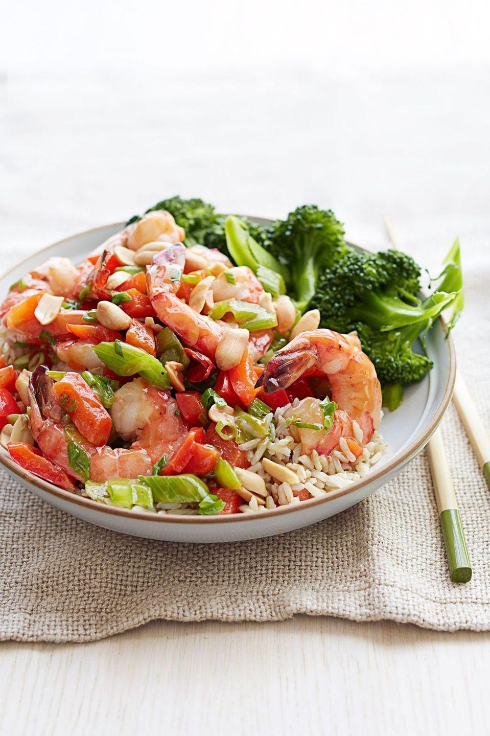 """<p>Greens, proteins, grains —you've got all your bases covered with this well-balanced meal. </p><p><em><a href=""""https://www.goodhousekeeping.com/food-recipes/a15598/kung-pao-shrimp-recipe-ghk0214/"""" rel=""""nofollow noopener"""" target=""""_blank"""" data-ylk=""""slk:Get the recipe for Kung Pao Shrimp »"""" class=""""link rapid-noclick-resp"""">Get the recipe for Kung Pao Shrimp »</a></em></p>"""