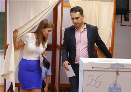Gabor Vona, the chairman of the far-right Jobbik party and his wife Krisztina leave a ballot booth to vote on the European Parliamentary elections in Budapest May 25, 2014. Reuters/Laszlo Balogh