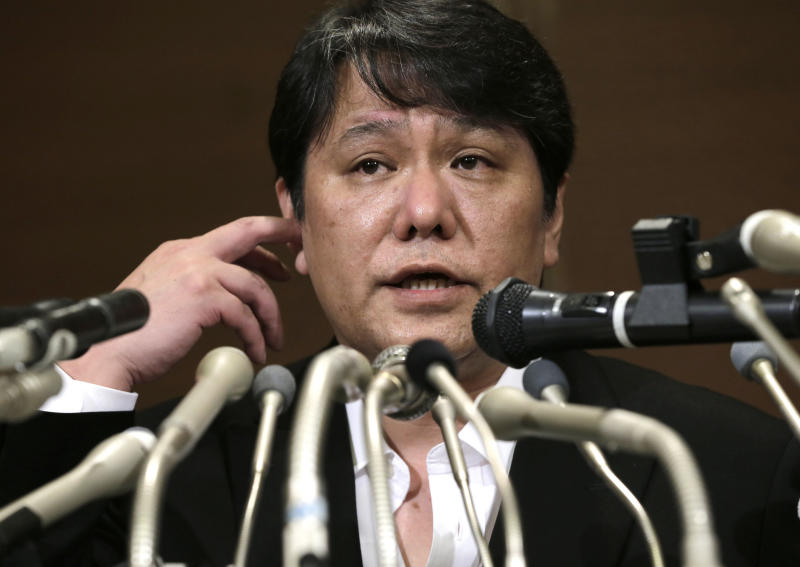 """Mamoru Samuragochi speaks during a press conference in Tokyo, Friday, March 7, 2014. The man once lauded as """"Japan's Beethoven"""" bowed repeatedly and apologized Friday at his first media appearance since it was revealed last month that his famed musical compositions were ghostwritten and he wasn't completely deaf. (AP Photo/Shuji Kajiyama)"""
