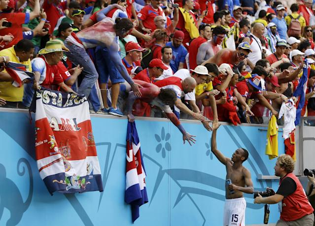 Costa Rica's Junior Diaz celebrates with fans following the team's 1-0 victory over Italy during the group D World Cup soccer match between Italy and Costa Rica at the Arena Pernambuco in Recife, Brazil, Friday, June 20, 2014. (AP Photo/Ricardo Mazalan)