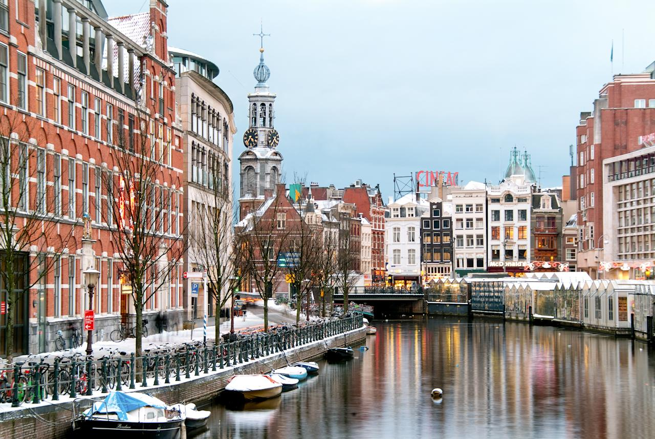 """<a href=""""https://www.cntraveler.com/destinations/amsterdam?mbid=synd_yahoo_rss"""">Amsterdam</a> celebrates the holidays for the entire month. Early in December, the focus is on <em>Sinterklaas</em>, the local answer to Santa, whom legend says spends much of the year in Spain before returning to Holland in mid-November. Head there on December 5, the evening before the Feast of Saint Nicholas, to experience <em>Sinterklaasavond</em> (Sinterklaas evening) or <em>Pakjesavond</em> (gift evening), which is the main gift-giving event of the season: Expect lots of celebrations throughout the city, and opportunities to sample pepernoten (spiced cookies) and marzipan treats. If you miss that date, don't worry, as there are more than two dozen Christmas markets dotted throughout <a href=""""https://www.cntraveler.com/story/3-days-in-amsterdam?mbid=synd_yahoo_rss"""">Amsterdam</a>, from historic Haarlem to the Winter Village Stadshart, where there's also an ice rink. Amsterdam's center is also festooned with installations via the annual Light Festival—view the works on foot, by bike or even better, on a special nighttime cruise. Then there's the 250-year-old World Christmas Circus, featuring acrobats, trapeze artists and other acts; it runs for three weeks at the Royal Theatre Carré. In fact, there's so much going on this month here, consider booking a <a href=""""https://www.originaltravel.com/"""">tour</a> to help you squeeze everything in."""
