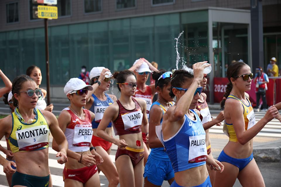 Tokyo 2020 Olympics - Athletics - Women's 20km Walk - Sapporo Odori Park, Sapporo, Japan - August 6, 2021. Antonella Palmisano of Italy in action as she pours water over her alongside Jemima Montag of Australia, Maria Perez of Spain and Yang Jiayu of China REUTERS/Kim Hong-Ji