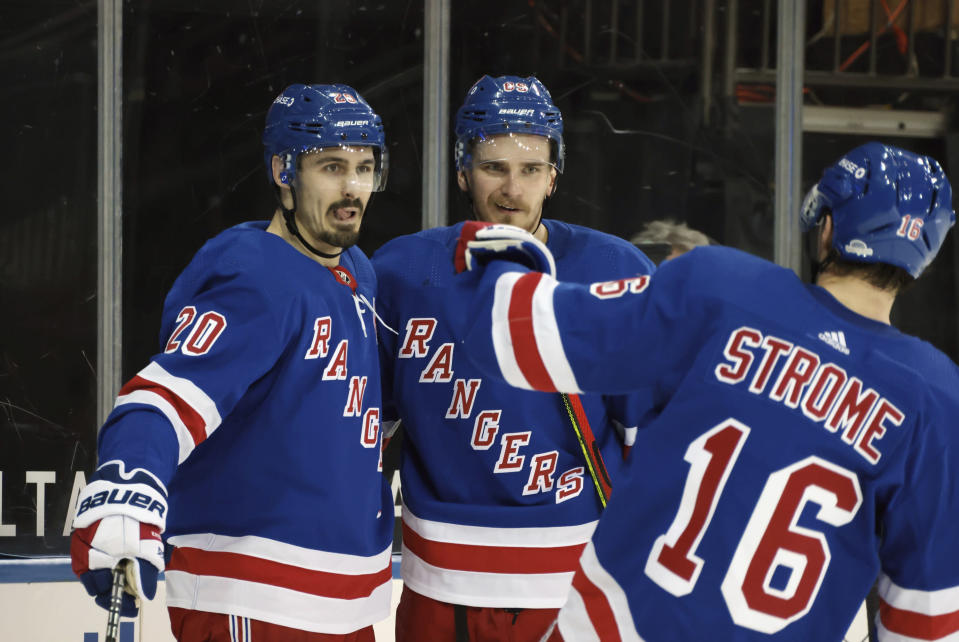 New York Rangers' Chris Kreider, left, celebrates his second-period goal against the Buffalo Sabres during an NHL hockey game Tuesday, March 2, 2021, in New York. (Bruce Bennett/Pool Photo via AP)