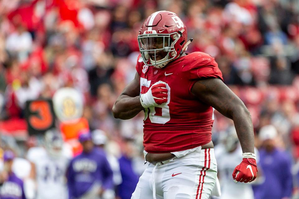 Alabama defensive lineman Christian Barmore (58) celebrates a sack against Western Carolina during the first half of an NCAA college football game in Tuscaloosa, Ala.