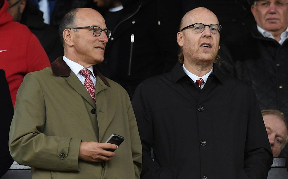 Joel Glazer (left) apologised to fans in an open letter after the Super League debacle - AFP