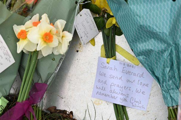 PHOTO: Bunches of flowers and messages of condolence  for Sarah Everard are seen at the woodland where police officers found human remains near Ashford, southeast England, on March 12, 2021. (Glyn Kirk/AFP via Getty Images)