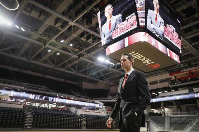 John Brannen walks the floor of Fifth Third Arena following a news conference to formally announce his hiring as Cincinnati's men's basketball coach after leading Northern Kentucky to two NCAA Tournament appearances in the last three years, Monday, April 15, 2019, in Cincinnati. Brannen replaces Mick Cronin, who left Cincinnati for the UCLA job. (AP Photo/John Minchillo)