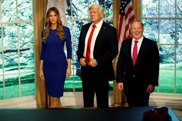 Former White House Press Secretary Sean Spicer poses next to a newly unveiled wax figure of first lady Melania Trump standing next to a wax figure of her husband, U.S. President Donald Trump, at the Madame Tussauds in New York City, New York, U.S., April 25, 2018. REUTERS/Mike Segar TPX IMAGES OF THE DAY