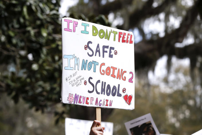<p>An activist holds up a placard during a rally at the Florida state Capitol building to address gun control on Feb. 21, 2018 in Tallahassee, Fla. (Photo: Don Juan Moore/Getty Images) </p>