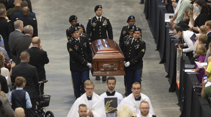 A Fort Riley honor guard carries the remains of Father Emil to an alter during Kapaun's funeral mass on Wednesday, Sept., 29, 2021 in Wichita, Kan. Kapaun died in a North Korean POW camp in May of 1951. He was posthumously awarded the Medal of Honor in 2013 for his bravery in the Korean War. Kapaun's remains were identified earlier this year returned home to Kansas recently. (Travis Heying/The Wichita Eagle via AP)