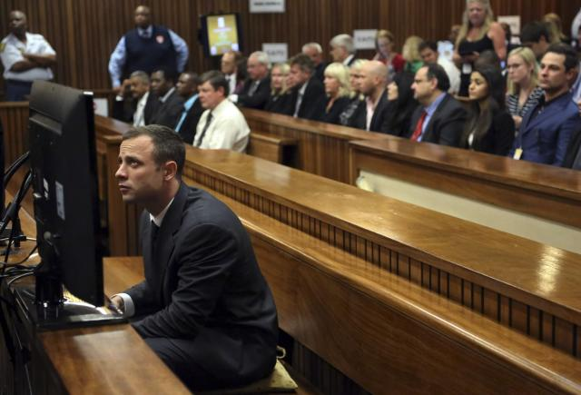 "Oscar Pistorius sits in court ahead of his trial at the North Gauteng High Court in Pretoria March 3, 2014. ""Blade Runner"" Pistorius arrived at the Pretoria High Court on Monday for the start of his murder trial, opening a decisive chapter in the story of the rise and fall of one of the world's best-known athletes. REUTERS/Themba Hadebe/Pool (SOUTH AFRICA - Tags: SPORT ATHLETICS CRIME LAW)"