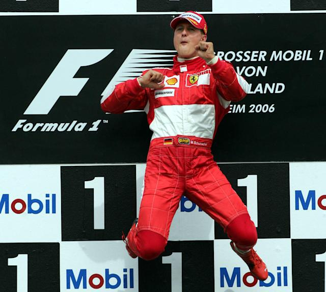 FILE - In this Sunday, July 30, 2006 file photo, German Ferrari racer Michael Schumacher jumps up on the podium after winning the Formula 1 Grand Prix of Germany at the Hockenheim Ring circuit in Hockenheim, southern Germany. As Formula One drivers prepare to contest the season-opening Australian Grand Prix on March 25, 2018 far away on another continent F1s most successful driver continues a very different fight. Respect remains huge for Michael Schumacher, the seven-time F1 champion whose feats will never be forgotten and records maybe never beaten. (AP Photo/Michael Probst, File)