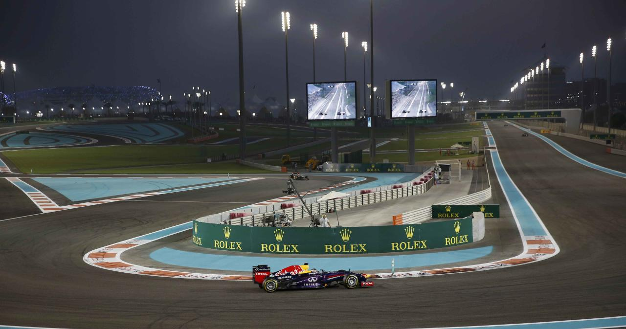 Red Bull Formula One driver Sebastian Vettel of Germany (C) takes a corner the qualifying session of the Abu Dhabi F1 Grand Prix at the Yas Marina circuit on Yas Island, November 2, 2013. REUTERS/Steve Crisp (UNITED ARAB EMIRATES - Tags: SPORT MOTORSPORT SPORT MOTORSPORT F1)