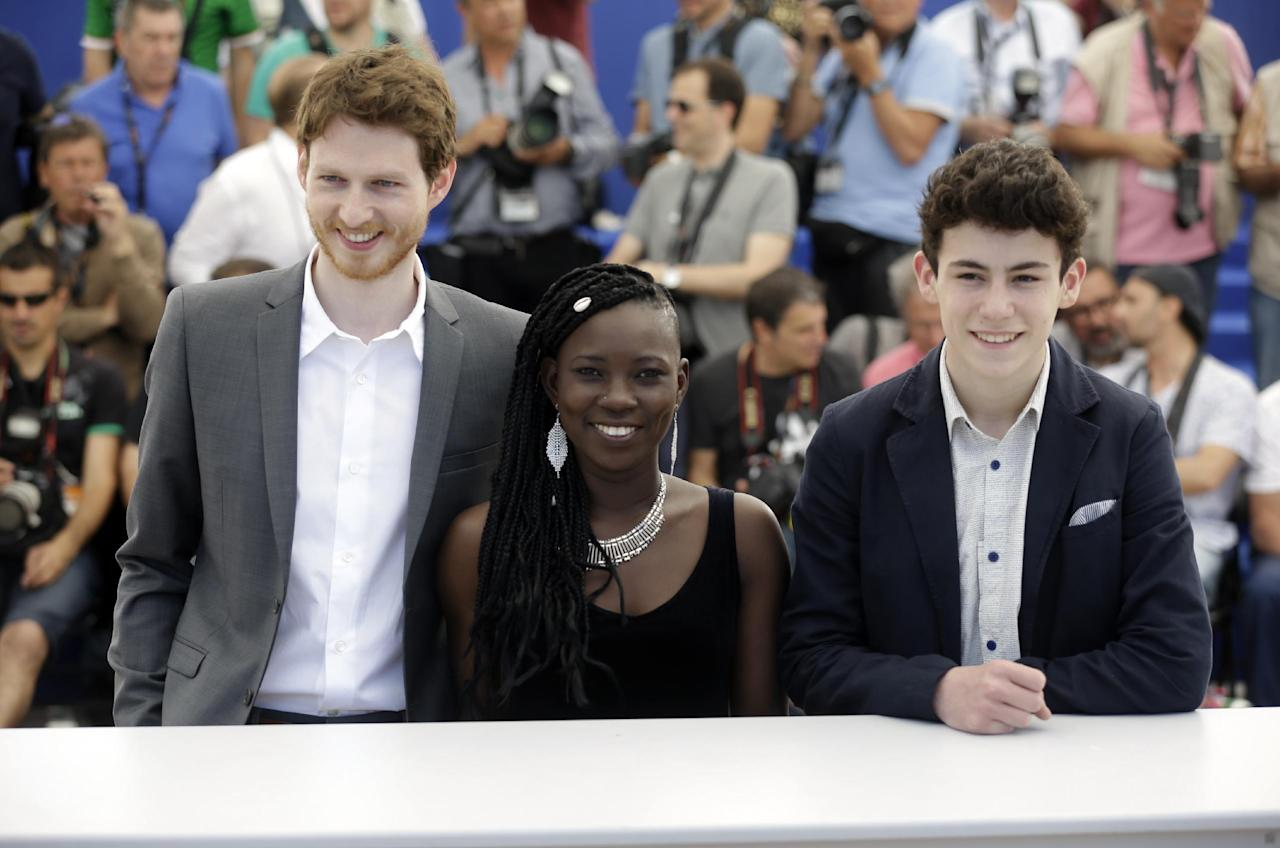 Actors Olivier Bonnaud, Nadege Ouedraogo and Louka Minnella, from left, pose for photographers during a photo call for the film La Fille Inconnue (The Unkown Girl) at the 69th international film festival, Cannes, southern France, Wednesday, May 18, 2016. (AP Photo/Lionel Cironneau)