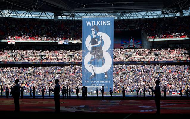 "Wembley united to pay tribute to Ray Wilkins during the FA Cup Final, as two of his former clubs battled it out for the domestic season's last piece of silverware. Wilkins, who played for Chelsea and Manchester United in a distinguished career, died of a heart attack last month at the age of 61. Wilkins wore the No.8 shirt for both clubs and Wembley was the scene of one of his most celebrated goals - a curling shot from distance for United against Brighton in the 1983 FA Cup final. There were banners at both the red and blue ends of Wembley to honour Wilkins, who won 84 England caps. In a nod to his shirt number both sets of supporters sang 'there's only one Ray Wilkins' in the eighth minute of the final. There was also a tribute to the man known as 'Butch' in the matchday programme. The England midfielder also won the Cup three times as a coach at Chelsea, including alongside Carlo Ancelotti as part of a domestic Double in 2010. His family were invited to spend the day in Wembley's Royal Box with widow Jackie presenting the trophy to the winning captain. Wilkins' son Ross said: ""The FA invited us into the Royal Box. It is an amazing thing to do. It will be an extremely emotional day, given the teams and history, but to effectively hold it in Dad's memory is unreal. Ray Wilkins scored a stunning goal for Man Utd in the 1983 final Credit: Getty Images ""It is one of the biggest sporting events globally but it will be doubled with emotion and I think that will probably take over. That mum is being allowed to present the trophy is just phenomenal. It is a lovely gesture from the FA."" In an exclusive interview with the Daily Telegraph, former Chelsea manager Eddie McCreadie recalled handing Wilkins the Chelsea armband at the age of 18. ""Butch was a player I wanted to rebuild the team around,"" said McGreadie. ""I remember when I told him he was to be my captain, him saying to me: 'You think I can do it?' I never had a moment's doubt."" A Chelsea legends XI played an exhibition match in Wilkins' memory against an Inter legends team at Stamford Bridge on Friday night."
