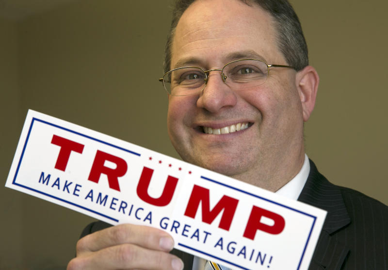 In this Jan. 11, 2017 photo, Trey Trainor, an Austin attorney specializing in election law who played a critical role for the Trump campaign at the Republican convention, poses with a Trump campaign sticker at the Akerman Law Firm in Austin, Texas. The White House announced on Tuesday, Sept. 13, 2017, that President Donald Trump has appointed Trainor to the Federal Election Commission. (Ralph Barrera/Austin American-Statesman via AP)