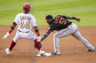 Washington Nationals' Starlin Castro (14) beats the tag of Baltimore Orioles second baseman Hanser Alberto (57) during the first inning of a baseball game in Washington, Friday, Aug. 7, 2020. (AP Photo/Manuel Balce Ceneta)