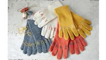 """<p>Bring a bit of earnest irony to a pair of gloves with this hilariously tender riff on tough knuckle tattoos. Borrow our intentionally sweet phrases above, or come up with your own eight-letter expressions. We chose <span class=""""redactor-unlink"""">wool-blend gloves</span><em>, </em>but any knit version will work.</p><p><strong>Step 1:</strong> Slide one glove onto your hand. Using a pastel chalk pencil<em>, </em>mark each knuckle with a horizontal line at the bottom of each finger (the first joint) and another just below the second joint. Remove the glove, then repeat for the other hand. If needed, enlist a friend to mark your dominant hand.</p><p><strong><strong>Step</strong> 2:</strong> Lay the gloves, marked sides up, on a flat surface. Working within the horizontal lines, and using the chalk pencil, spell out the phrase you plan to stitch across both gloves. Try the gloves on to check that your letters are positioned to satisfaction.</p><p><strong><strong>Step</strong> 3:</strong> Using six-strand embroidery thread that contrasts with the color of your gloves<em>, </em>sew directly over the chalk letters with a basic stem stitch, making sure to sew through the top layer only. (Get a quick <a href=""""https://www.countryliving.com/diy-crafts/how-to/a4240/stem-stitch-tutorial/"""" rel=""""nofollow noopener"""" target=""""_blank"""" data-ylk=""""slk:stem-stitch tutorial here"""" class=""""link rapid-noclick-resp"""">stem-stitch tutorial here</a>.) Remove any stray chalk with a damp cotton swab—and spread the word!</p>"""
