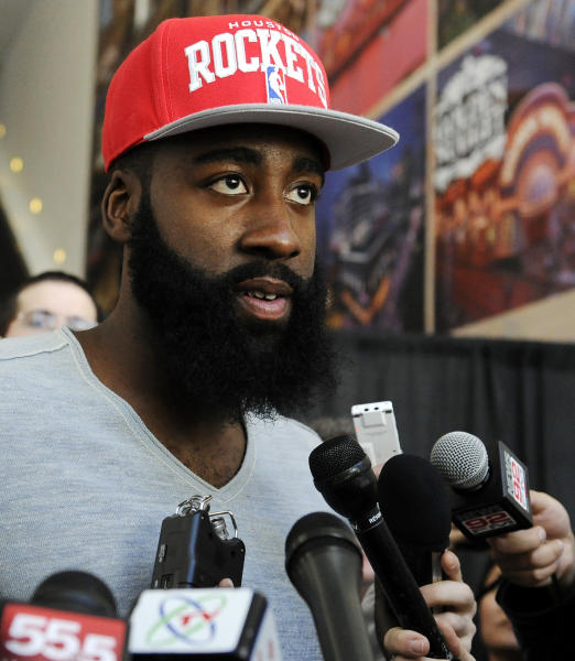 Newly acquired Houston Rockets guard James Harden speaks at an NBA basketball news conference, Monday, Oct. 29, 2012, in Houston. Rockets general manager Daryl Morey officially introduced Harden on Monday. Harden joined Houston in a stunning trade with the Oklahoma City Thunder on Saturday night. (AP Photo/Pat Sullivan)