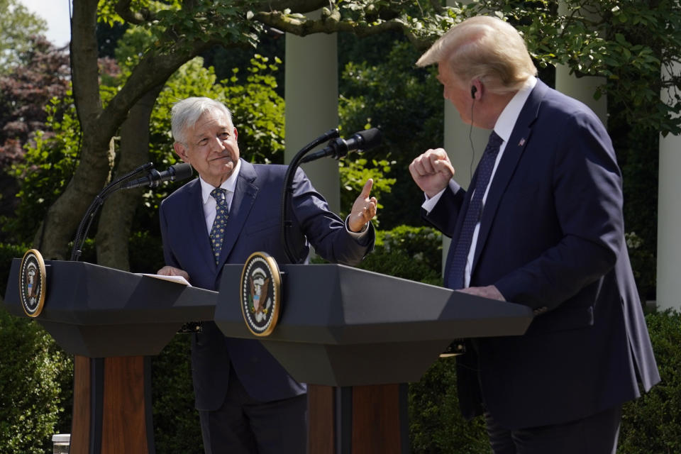 President Donald Trump and Mexican President Andres Manuel Lopez Obrador gesture before signing a joint declaration at the White House, Wednesday, July 8, 2020, in Washington. (AP Photo/Evan Vucci)