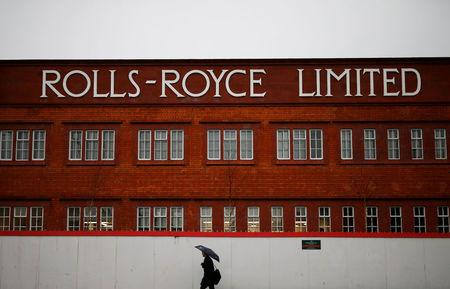 FILE PHOTO: A man walks past a former Rolls Royce site in Derby, Britain February 12, 2016.  REUTERS/Darren Staples/File Photo