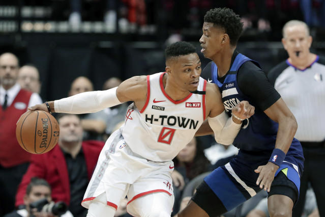 Houston Rockets guard Russell Westbrook (0) drives into Minnesota Timberwolves guard Jarrett Culver (23) during the first half of an NBA basketball game Saturday, Jan. 11, 2020, in Houston. (AP Photo/Michael Wyke)