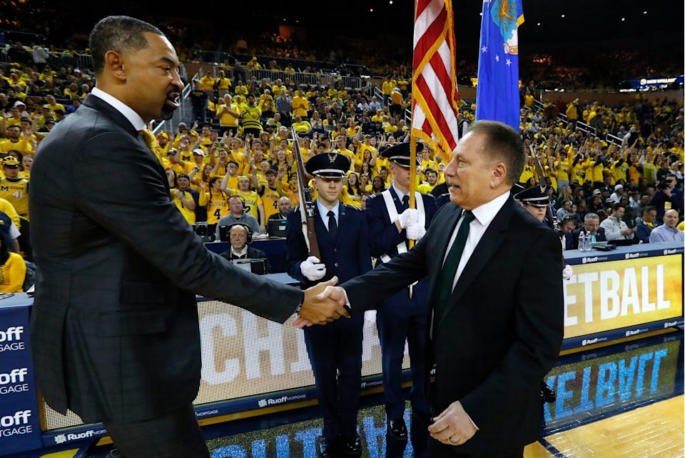 Michigan coach Juwan Howard, left, and Michigan State coach Tom Izzo shake hands before their game in Ann Arbor, Saturday, Feb. 8, 2020.