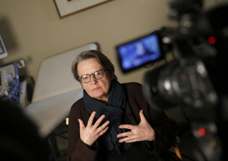 "Polish director Agnieszka Holland answers an Associated Press reporter during the shooting of the adaptation of the psychological horror movie ""Rosemary's Baby"" in Issy-les-Moulineaux, outside Paris, Friday March 7, 2014. ""The storyline is pretty much the same,"" said Holland, a three-time Oscar nominee. ""It has more of adventures, it has more blood, it has more of gore because it is, you know, a contemporary American TV series so you need some meat inside."" (AP Photo/Christophe Ena)"