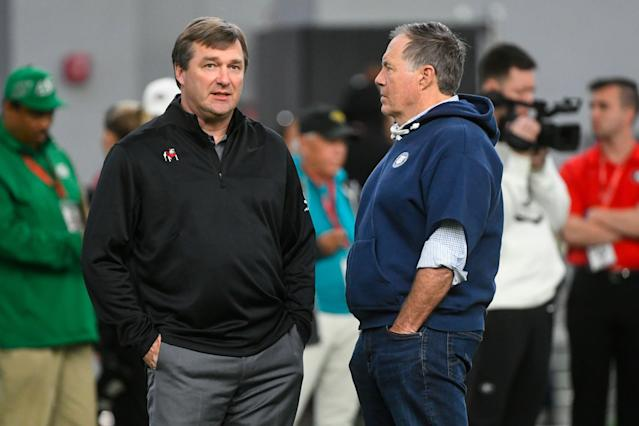 Georgia coach Kirby Smart (L) and New England Patriots coach Bill Belichick converse during Georgia Pro Day on March 20. (AP)