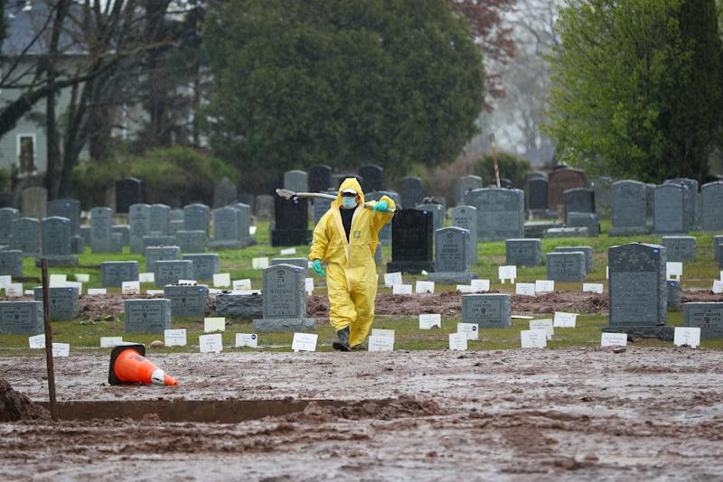 A gravedigger is seen at the Mount Richmond Cemetery which receives Covid-19 deaths in the Staten Island borough of New York in April. Source: Getty