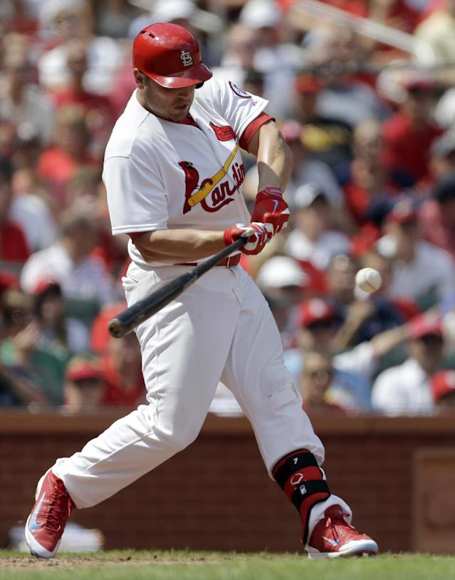 St. Louis Cardinals' Matt Holliday hits an RBI double during the fifth inning of a baseball game against the Pittsburgh Pirates on Thursday, Aug. 15, 2013, in St. Louis. (AP Photo/Jeff Roberson)