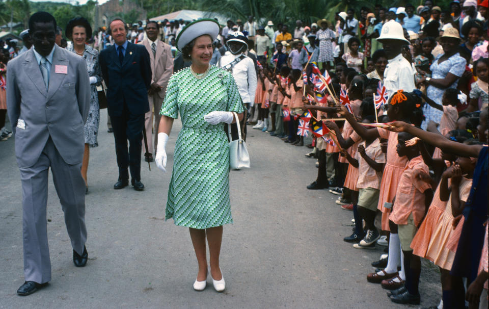 BARBADOS - NOVEMBER 01:  Queen Elizabeth ll is greeted by the public during a walkabout in Barbados on November 01, 1977 in Barbados. (Photo by Anwar Hussein/Getty Images)