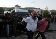 FILE PHOTO: Soldiers suspected of being involved in the coup attempt are escorted by policemen as they arrive at a courthouse in the resort town of Marmaris
