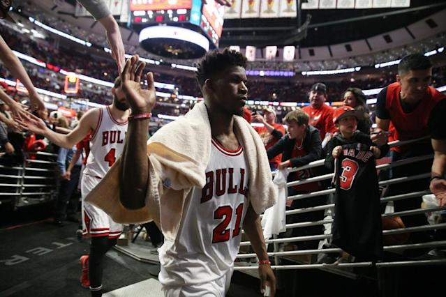 "<a class=""link rapid-noclick-resp"" href=""/nba/players/4912/"" data-ylk=""slk:Jimmy Butler"">Jimmy Butler</a> high-fives fans as he leaves the court at United Center. (Terrence Antonio James/Chicago Tribune/TNS/Getty Images)"
