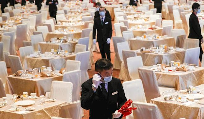 Tables of four were set up inside the convention centre to abide by social-distancing rules. Photo: Nora Tam