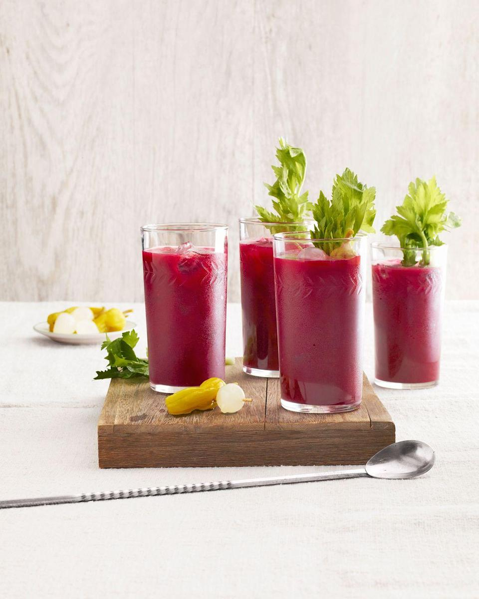"""<p>Kick off mom's celebration by presenting her with an updated twist on the classic Bloody Mary. </p><p><strong><a href=""""https://www.countryliving.com/food-drinks/recipes/a4591/spicy-beet-bloody-marys-recipe-clv0314/"""" rel=""""nofollow noopener"""" target=""""_blank"""" data-ylk=""""slk:Get the recipe"""" class=""""link rapid-noclick-resp"""">Get the recipe</a>.</strong><br></p>"""