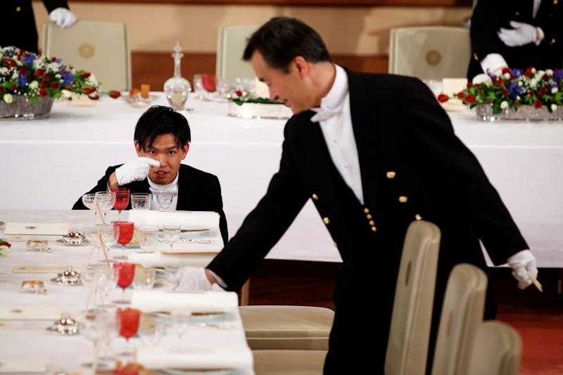 Attendants prepare for a State Banquet hosted by Japanese Emperor Naruhito at the Imperial Palace in honor of President Donald Trump, Monday, May 27, 2019, in Tokyo.