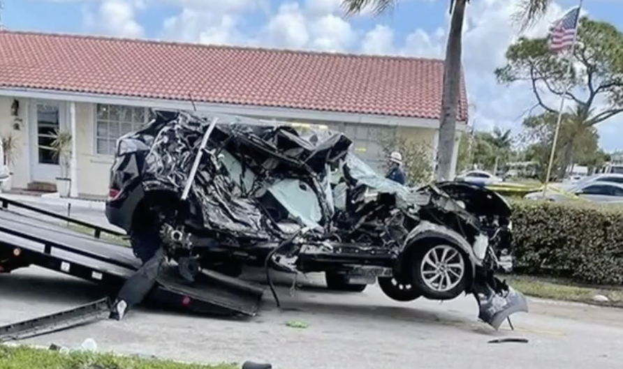 The crumpled SUV after the crash.
